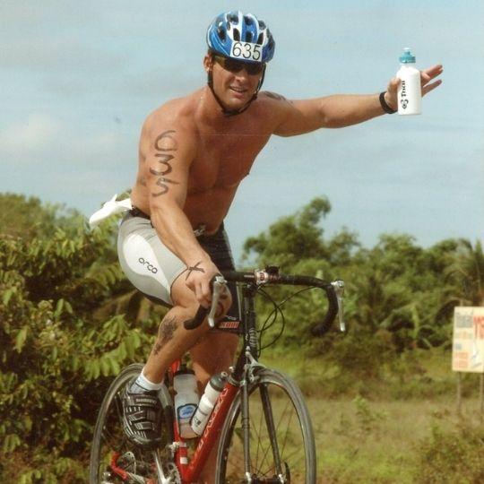 Jack Kautz biking Ironman Triathlon